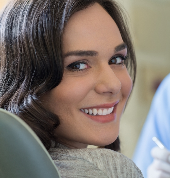 Woman with healthy smile after periodontal therapy