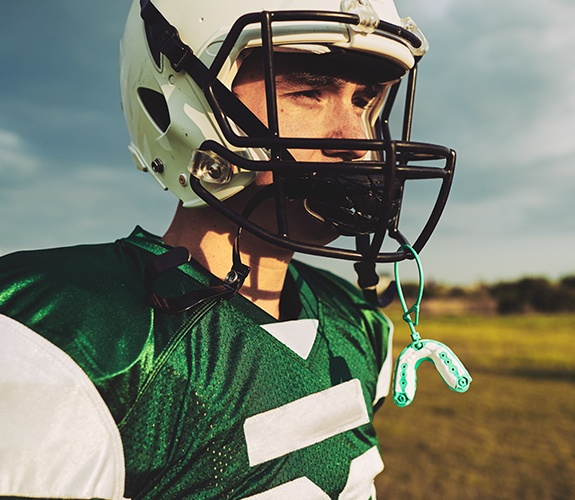 Teen boy with green athletic mouthguard